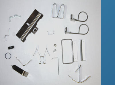 A selection of brackets, springs and clips